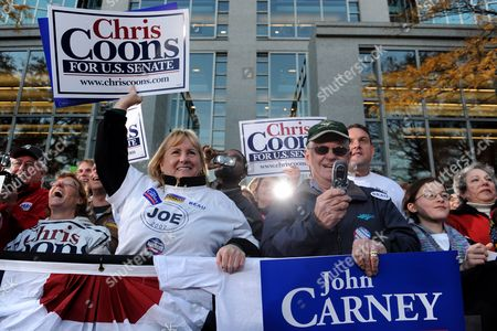 Supporters of Democratic Candidate For Senate Chris Coons of Delaware and Democratic Candidate For the House of Representatives John Carney of Delaware Hold Up Signs at a Rally For Democratic Candidates on the Eve of Midterm Elections in Wilmington Delaware Usa 01 November 2010 United States Wilmington
