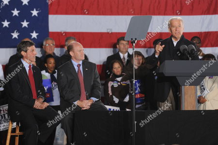 Us Vice President Joe Biden (r) Delivers Remarks Beside Democratic Candidate For Senate Chris Coons (c) of Delaware and Democratic Candidate For the House of Representatives John Carney (l) of Delaware at a Rally For Democratic Candidates on the Eve of Midterm Elections in Wilmington Delaware Usa 01 November 2010 United States Wilmington