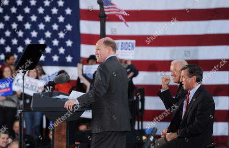 Democratic Candidate For Senate Chris Coons (c) of Delaware Delivers Remarks Beside Democratic Candidate For the House of Representatives John Carney (front R) of Delaware and Us Vice President Joe Biden (back R) at a Rally For Democratic Candidates on the Eve of Midterm Elections in Wilmington Delaware Usa 01 November 2010 United States Wilmington