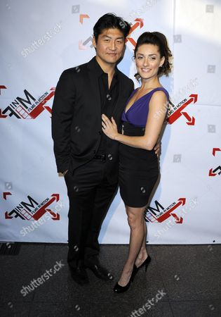 A Picture Made Available on 26 April 2011 Shows Japanese Actor Brian Tee (l) and Mexican Actress Mirelly Taylor (r) As They Arrive For the Premiere of 'Blood Out' in Los Angeles California Usa 25 April 2011 'Blood Out' is a Good Cop/bad Cop Action Drama United States Los Angeles