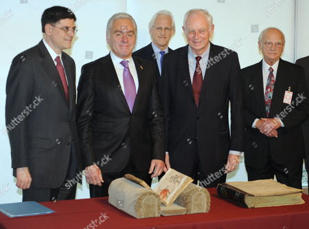 Us Army Veteran John Pistone (r) Ambassador of the Federal Republic of Germany to the United States Klaus Scharioth (2-r) Robert M Edsel (c) of the Monuments Men Foundation Minister of the Interior For the State of Baden-wuerttemberg Heribert Rech (2-l) and Us Deputy Secretary of Resources Jack Lew (l) Attend a Ceremony That Marks the Return to Germany of Two Objects of Historical Interest Taken by Members of the Us Armed Forces During World War Ii at the State Department in Washington Dc Usa 22 January 2010 One Object (front L) Relates to the Paintings Designated For the Museum That Adolf Hitler Planned to Establish in Linz Austria and the Other (front R) is a Genealogical Volume United States Washington