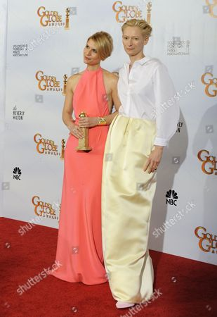 Us Actress Claire Danes (l) and British Actress Tilda Swinton Pose with Danes Award For Best Performance by an Actress in a Mini-series Or Motion Picture Made For Television For 'Temple Grandin' in the Press Room at the 68th Golden Globe Awards Held at the Beverly Hilton Hotel in Los Angeles California Usa 16 January 2011 United States Los Angeles