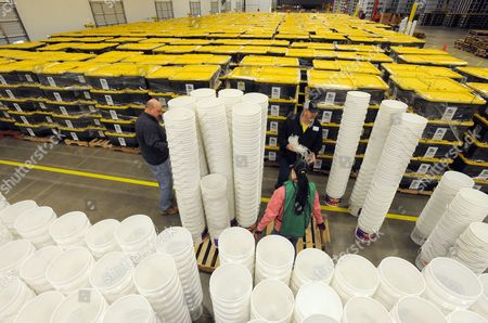 Habitat For Humanity Volunteers Russ Griffith (l) Heather Nothstein (c) and Mike Chapman Assemble Buckets to Be Included in Emergency Shelter Kits Bound For Earthquake-ravaged Haiti at an Appliance Warehouse in Mcdonough Georgia Usa on 11 February 2010 Habitat For Humanity is Assembling About 10 000 of the Kits Which Contain Tools and Supplies to Help Haitian Families Make Immediate House Repairs and Construct Shelters on Their Home Sites the Organization Hopes to Build 50 000 Permanent Homes Over the Next Few Years United States Mcdonough