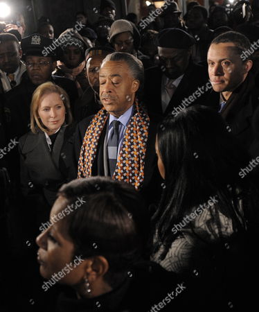 Rev Al Sharpton (c) Leads a Group Including Us Senator Kirsten Gillibrand (l) Democrat-ny and Former Congressman Harold Ford Jr (r) in a Prayer For Earthquake Victims Following a Press Conference in Reaction to the Massive Earthquake in Haiti in New York New York Usa 13 January 2010 Haitian President Rene Preval Said 13 January Estimates of the Death Toll in the Devastating Earthquake in Capital Port-au-prince Could Easily Be in the Tens of Thousands While Other Officials Said More Than 100 000 May Have Perished United States New York