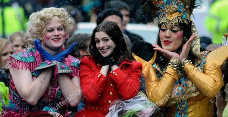 Actress Anne Hathaway the 2010 Hasty Pudding Theatricals Woman of the Year Poses with Clifford Murray (l) and Derek Mueller (r) During Her Honorary Parade Through Harvard Square in Cambridge Massachusetts Usa 28 January 2010 the Woman of the Year Award is Presented Annually to a Performer who Has Made a 'Lasting and Impressive Contribution to the World of Entertainment ' and Hathaway Joins Other Past Honorees Including Meryl Streep Katharine Hepburn Julia Roberts Jodie Foster Meg Ryan and Most Recently Renee Zellwegger United States Cambridge