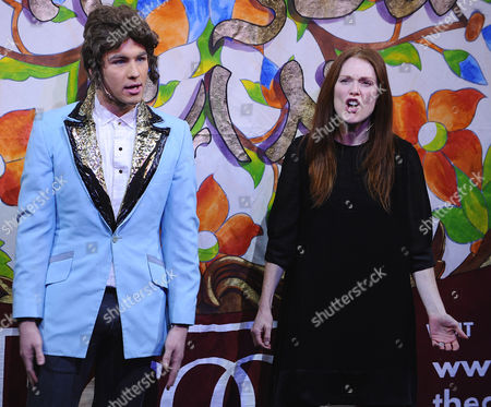 Us Actress Julianne Moore (r) and a Hasty Pudding Theatricals Cast Member Dressed As Actor Mark Wahlberg (l) During the Roast Session of the 2011 Hasty Pudding Theatricals Woman of the Year Award Presentation in Cambridge Massachusetts Usa 27 January 2011 the Woman of the Year Award is Presented Annually to a Performer who Has Made a 'Lasting and Impressive Contribution to the World of Entertainment and Hathaway Joins Other Past Honorees Including Meryl Streep Katharine Hepburn Julia Roberts Jodie Foster Meg Ryan and Most Recently Anne Hathaway United States Cambridge
