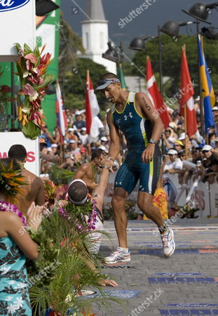 Chris Mccormack of Australia Congratulates Fellow Countryman Craig Alexander on His Second Consecutive Win During the Ironman World Championship in Kailua-kona Hawaii Usa on 10 October 2009 United States Kailua Kona
