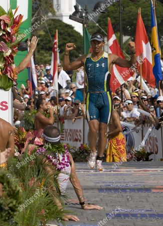 Former Champion Chris Mccormack of Australia Crosses the Finish Line in Fourth Place with During the Ironman World Championship in Kailua-kona Hawaii Usa on 10 October 2009 United States Kailua Kona