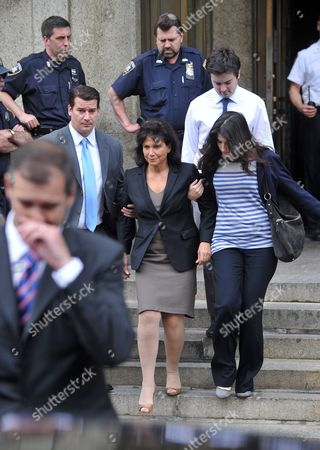 Stock Image of Former Head of the International Money Fund Dominique Strauss-khan's Wife Anne Sinclair (c) and Her Daughter Camille Strauss-kahn (r) Leave Manhattan Criminal Court 19 May 2011 in New York Strauss-kahn the Former Head of the International Money Fund Faced Arraignment 19 May on Charges of Attempted Rape and Criminal Sexual Contact in the Alleged Attack on a Maid who Went Into His Penthouse Suite at a Hotel Near Times Square on Saturday United States New York