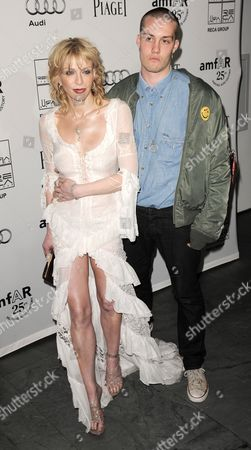 Stock Image of Singer Courtney Love (l) of the Us and Us Musician Jack Donoghue (r) Arrive For the Amfar Inspiration Gala at the Museum of Modern Art in New York New York Usa on 14 June 2011 United States New York