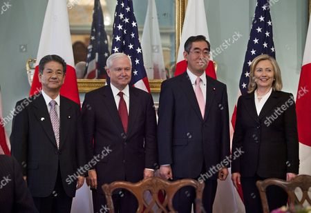 Stock Picture of U S Secretary of State Hillary Clinton (r) and Defense Secretary Robert Gates (c-l) Pose with Japanese Foreign Minister Takeaki Matsumoto (c-r) and Japanese Defense Minister Toshimi Kitazawa (l) Before a Japan Security Consultive Committee Meeting at the State Department in Washington Dc Usa on 21 June 2011 United States Washington