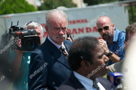 Dove World Outreach Center Church Pastor Terry Jones Listens to Dr K a Paul of the Global Peace Initiative As He Spoke to the Press About the Planned Negotiations with Imam Feisal Abdul Rauf of New York City in Gainesville Florida Usa 10 September 2010 Jones is Leader of a Small Protestant Church Which Campaigns Against what It Calls 'Radical Islam ' Since Jones Announced the Cancellation of the Koran Burning Event in Exchange For the Movement of the Location of the Mosque Near Ground Zero in New York City There Has Been Much Confusion Over the Details of the Agreement United States Gainesville