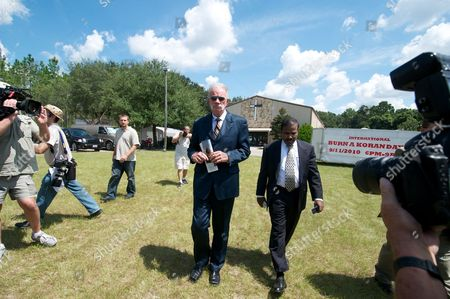 Dove World Outreach Center Church Pastor Terry Jones Leaves His Church with Dr K a Paul of the Global Peace Initiative Before He Spoke to the Press About His Planned Negotiations with Imam Feisal Abdul Rauf of New York City in Gainesville Florida Usa 10 September 2010 Jones is Leader of a Small Protestant Church Which Campaigns Against what It Calls 'Radical Islam ' Since Jones Announced the Cancellation of the Koran Burning Event in Exchange For the Movement of the Location of the Mosque Near Ground Zero in New York City There Has Been Much Confusion Over the Details of the Agreement United States Gainesville