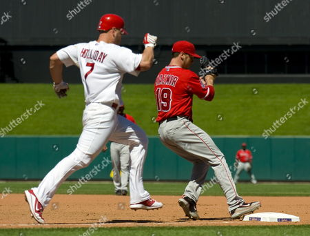 Stock Photo of Los Angeles Angels Scott Kazmir (r) Beats St Louis Cardinals Matt Holliday to First Base For an out at Busch Stadium in St Louis Missouri Usa on 22 May 2010 United States St. Louis