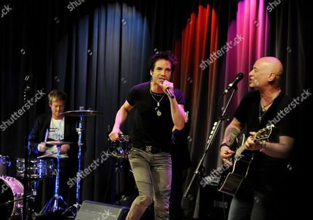 Us Band Train Drummer Scott Underwood (l) Singer Patrick Monahan (c) and Guitarist Jimmy Stafford (r) Perform the Song 'Save Me San Francisco' During Their Performance to Benefit the Grammy Museum and Grammy Foundation in Los Angeles California Usa 19 July 2010 the Grammy Museum Hosts Intimate Events with Bands and Musicians in Which They Discuss Their Careers Musical Influences and Answer Questions From Fans Before Playing a Short Set of Their Songs United States Los Angeles