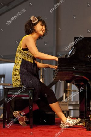Japanese Jazz Composer and Pianist Hiromi Uehara Performing on the Jazztent Stage at the New Orleans Jazz and Heritage Festival at the New Orleans Fair Grounds Race Course in New Orleans Louisiana Usa 30 April 2010 the New Orleans Jazz and Heritage Festival Celebrates It's 41st Anniversary This Year with 12 Different Stages in an Annual 7-day Multi-cultural Event That Encompasses Both International Music and Every Form of Music Associated with the City of New Orleans and Southern Louisiana Including Jazz Gospel Cajun Zydeco Blues Rhythm and Blues Rock Funk African Latin Caribbean Folk and More in Addition to Local Cuisine Arts and Crafts United States New Orleans