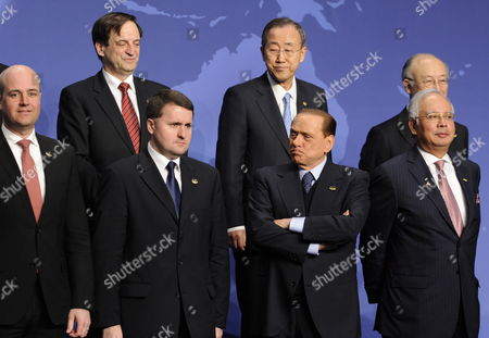 Italian Prime Minister Silvio Berlusconi (2nd R Front Row) Joins World Leaders For a Group Photo Prior to the Opening Plenary of the Nuclear Security Summit 13 April 2010 in Washington D C Usa (l-r Front Row) Are: Sweden's Prime Minister Fredrik Reinfeldt Poland's Ambassador to the Us Robert Kupiecki and Malaysia's Prime Minister Dato' Sri Mohd Najib Bin Bin Tun Haji Abdul Razak (l-r Back Row): Israel's Deputy Prime Minister and Minister of Intelligence and Atomic Energy Dan Meridor United Nation's Secretary-general Ban Ki-moon and Iaea Director General Yukiya Amano the Summit is Meeting to Discuss Safeguarding Nuclear Weapons and Non-proliferation United States Washington