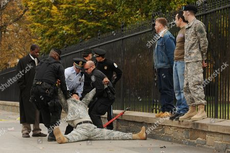Dan Choi (bottom L) a Former Lieutenant in the Us Army That was Dishonorably Discharged For Being Gay is Forcibly Removed and Arrested by Us Park Police After Handcuffing Himself to the Fence Outside the North Lawn of the White House with Veterans and Advocates For Gay Lesbian Bisexual and Transgender Civil Rights in Washington Dc Usa 15 November 2010 Thirteen Members of the Civil Rights Organization Getequal Handcuffed Themselves to the North Lawn's Fence Before Getting Arrested the Protesters Urged President Obama and the Us Congress to Repeal the 'Don't Ask Don't Tell' Policy United States Washington