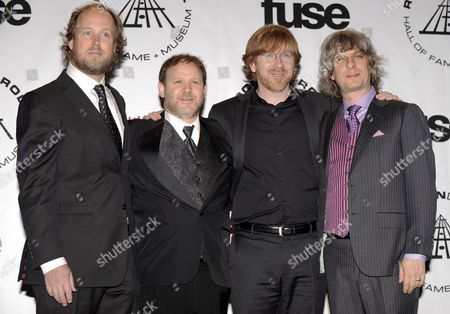 From Left Page Mcconnell Trey Anastasio Jon Fishman and Mike Gordon of the Band Phish Appear in the Press Room at the 2010 Rock and Roll Hall of Fame Induction Ceremony at the Waldorf Astoria in New York New York Usa on 15 March 2010 United States New York
