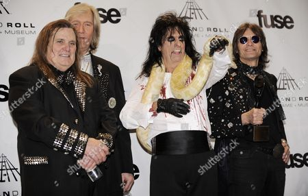 From Left Musicians Michael Bruce Neal Smith Alice Cooper and Dennis Dunaway Pose in the Press Room After Alice Cooper was Inducted Into Rock and Roll Hall of Fame During the 2011 Induction Ceremony at the Waldorf Astoria Hotel in New York New York Usa on 14 March 2011 United States New York