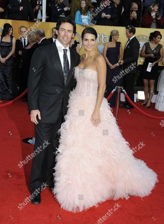 Stock Picture of Us Actress Angie Harmon (r) and Us Former Football Player and Husband Jason Sehorn Arrive For the 17th Annual Screen Actors Guild Awards Held at Shrine Auditorium in Los Angeles California Usa 30 January 2011 United States Los Angeles