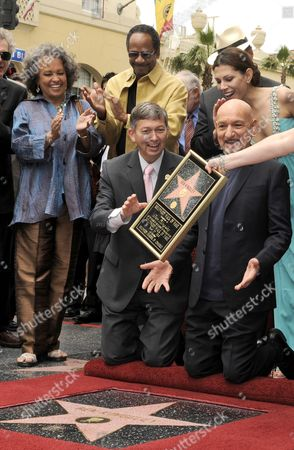 British Actor Sir Ben Kingsley (front R) Reaches For the Replica of His Star on the Hollywood Walk of Fame As Hollywood Chamber of Commerce President/ceo Leron Gubler (front L) Daphne Reid (back L) Us Actor Tim Reid (back C) and Kingsley's Wife Daniela Lavender (back R) Look on During Ceremony in Hollywood California Usa 27 May 2010 Kingsley was Awarded the 2 410th Star on the Hollywood Walk of Fame United States Hollywood