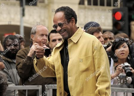 Stock Image of Us Actor Tim Reid Waves to Fans Prior to British Actor Sir Ben Kingsley's Star on the Hollywood Walk of Fame Ceremony in Hollywood California Usa 27 May 2010 Kingsley was Awarded the 2 410th Star on the Hollywood Walk of Fame United States Hollywood