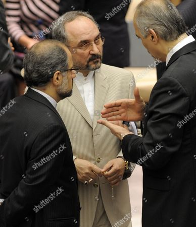 Stock Image of Mohammad Khazaee (c) Iran's Permanent Representative to the U N Talks with Bashar Ja'afari (r) Syria's Permanent Representative to the U N Before the United Nations Security Council Vote on New Sanctions Against Iran at United Nations Headquarters in New York New York Usa on 09 June 2010 the U S Drafted Sanctions Resolution Expands an Arms Embargo Targets Iran's Banking Sector and Bans the Country From Other Sensitive Activities United States New York