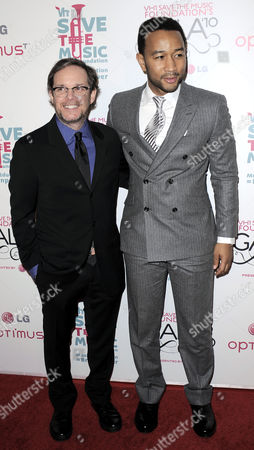 Stock Photo of Musician John Legend (r) of the Us Poses with Tom Calderone the President of Vh1 While They Arrive For the Vh1 Save the Music Foundation Gala in New York New York Usa on 08 November 2010 This Year's Gala was Being Held to Honor Julie Andrews John Legend and John Mayer United States New York