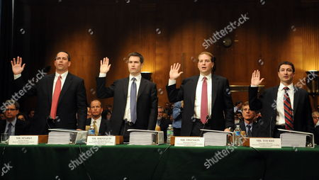 (l-r) Daniel L Sparks Former Partner Head of Mortgages Department the Goldman Sachs Group Inc Joshua S Birnbaum Former Managing Director Structured Products Group Trading at the Goldman Sachs Group Inc Michael J Swenson Managing Director Structured Products Group Trading at the Goldman Sachs Group Inc and Fabrice P Tourre Executive Director Structured Products Group Trading at the Goldman Sachs Group Inc Take the Oath Before Testifying Before the U S Senate Permanent Subcommittee on Investigations During a Hearing on 'Wall Street and the Financial Crisis: the Role of Investment Banks ' on Capitol Hill in Washington Dc Usa April 27 2010 the Hearing Focuses on the Role of Investment Banks in the Securitization of Residential Mortgage Related Products United States Washington