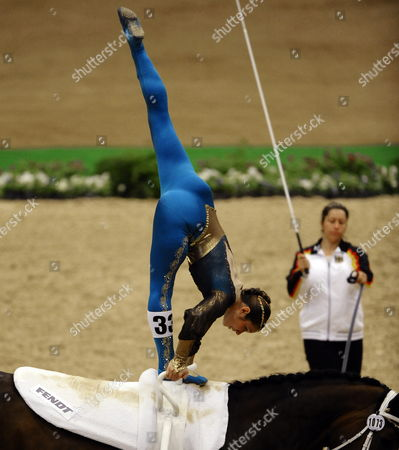 Sarah Kay From Germany (l) Performs on Weltoni Rs V Wintermuehle with the Help From Lunger Alexandra Knauf (r) While Competing in the Female Individual Freestyle Vaulting Championship at the World Equestrian Games in Lexington Kentucky Usa 07 October 2010 the World Equestrian Games Are Being Held Outside of Europe For the First Time United States Lexington