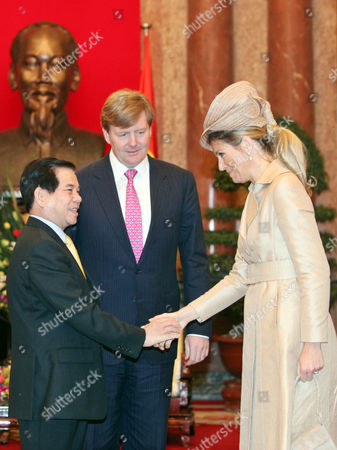 Stock Photo of Dutch Princess Maxima (r) and Vietnamese President Nguyen Minh Triet (l) Shake Hands at the Presidential Palace in Hanoi Vietnam 28 March 2011 Watched by Dutch Crown Prince Willem Alexander (c) Crown Prince Willem Alexander and Princess Maxima Are in Vietnam For a Four-day Visit the Purpose of the Official Visit is to Strengthen Trade Relations Between the Netherlands and Vietnam Viet Nam Hanoi