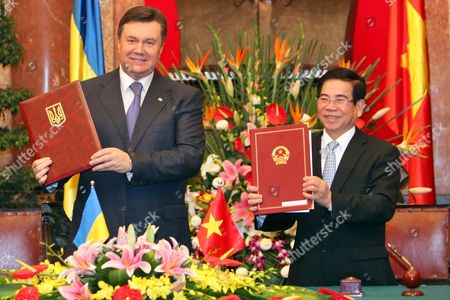 Ukrainian President Viktor Yanukovych (l) and His Vietnamese Counterpart Nguyen Minh Triet (r) Greet After Signing the Joint Declaration on Development Cooperation - Comprehensive Partnership Between Vietnam and Ukraine at the Presidential Palace in Hanoi Vietnam 26 March 2011 Yanukovych is on an Official Visit to Vietnam From 25 to 27 March 2011 Viet Nam Hanoi