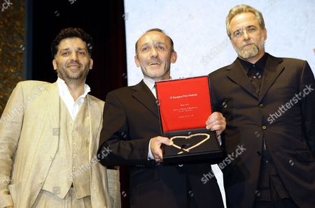 Austrian Director Karl Markovics (c) Poses with Bosnian Director Danis Tanovic (l) and Israeli Filmmaker Ari Folman (r) After Receiving the Heart of Sarajevo For the Best Film Award During the Award Night of the 17th Sarajevo Film Festival in Sarajevo Bosnia-herzegovina 30 July 2011 Markovics Received the Award For His Movie 'Atmen (breathing)' the Film Festival Took Place From 22 to 30 July Bosnia and Hercegovina Sarajevo