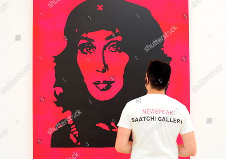 A Employee Looks at an Artwork Entitled Pink Cher by British Artist Scott King on Display in the Saatchi Gallery at Sloane Square in London Britain 01 July 2010 British Art Collector Charles Saatchi Announced on 01 July He is Donating His London Gallery Including More Than 200 Artworks Worth More Than 25 Million Gbp (37 7 Million Usd Or 30 3 Million Eur) to the British Nation the Artworks Being Donated Include Tracey Emin's My Bed and Chapman Brothers Works the Gallery Will Become the Museum of Contemporary Art (moca London) United Kingdom London