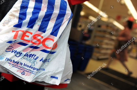 A Customer Carries a Tesco Shopping Bag From a Store in London Britain 06 October 2009 Tesco Chief Executive Sir Terry Leahy Has Said That the Supermarket Chain is 'Well-placed For the Global Recovery' After Reporting 'Solid' Results 06 October Britain's Biggest Retailer's Pre-tax Profits For the Six Months to the End of August Came in at 1 53bn Euros Which was Up 1 5% on the Same Period Last Year United Kingdom London