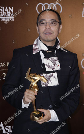 Thai Film Director Apichatpong Weerasethakul Poses For a Photograph After Winning the Film Award in His Film 'Unicle Boonmee who Can Recall His Past Lives' at the 5th Asia Film Awards in Hong Kong China 21 March 2011 As Part of the 35th Hong Kong International Film Festival (hkiff) the Festival Runs From 20 March to 05 April 2011 China Hong Kong