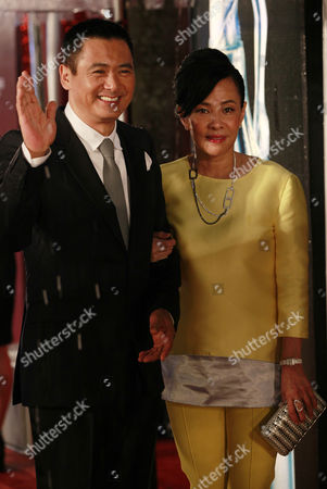 Hong Kong Actor Chow Yun Fat (l) Arrives As Nominee For Best Actor in His Movie Confucius Accompanied by His Wife Jasmine Tan (r) During the Opening Ceremony of the 30th Hong Kong Film Awards in Hong Kong China 17 April 2011 the Hong Kong Film Award Ceremony Honours Achievement in Film Making China Hong Kong