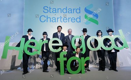 Peter Sands (4-l) Group Chief Executive Standard Chartered Plc and Benjamin Hung (3-l) Ceo Standard Chartered Bank (hong Kong) Limited Pose Photos with Dancers During a Press Conference where the Company Unveiled the Group's New Worldwide Brand Promise 'Here For Good' in Hong Kong China 29 April 2010 Standard Chartered 31 March Rolled out a Global Brand Campaign Focused on Its Commitment to Being a Positive Force in the Markets where It Operates Across Asia Africa and the Middle East the Bank Said 'The Campaign Will Help to Establish the Banks New Brand Promise Here For Good Underlining the Banks Distinctive Approach to International Banking and Creating a Strong Platform For Continued Growth ' China Hong Kong