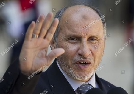 President of Libyan Council of National Transition (cnt) Mustafa Abdeljalil Waves As He Leaves the Elysee Palace After Meeting with French President Nicolas Sarkozy in Paris France 20 April 2011 Abdeljalil Met Sarkozy in a Bid to Maintain Diplomatic Momentum in the Absence of Military Progress in the Insurgents? Campaign Against Libya's Leader Colonel Muammar El-qaddafi France Paris