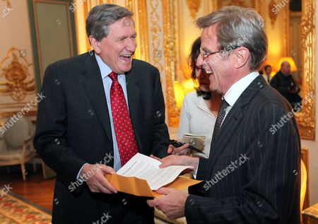 Us Special Envoy For Pakistan and Afghanistan Richard Holbrooke (l) Laughs with French Foreign Minister Bernard Kouchner (r) at a Reception in the Us Embassy in Paris France 19 January 2010 the Embassy Hosted a Reception in Honor of Holbrooke's Wife Journalist and Author Kati Marton who is Releasing a New Book Entitled 'Hidden Power' About Us First Ladies France Paris