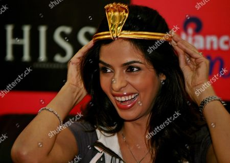 Bollywood Actress Mallika Sherawat Smiles During the Promotional Event of Her New Hollywood Movie 'Hisss' in the Southern City of Bangalore India 22 October 2010 Hollywood Movie 'Hisss' is Based on the Vengeance of Naagin Or the Snake Woman Directed by Jennifer Lynch India Bangalore