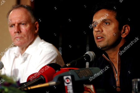 Indian Cricket Team Captain Rahul Dravid (r) Speaks As Coach Greg Chappell Looks on During a Press Conference in Bombay India on Monday 13 November 2006 Before Leaving For South Africa India Will Play Five One Day International Matches and Three Test Against South Africa the Series Will Start From 19 November 2006 India Bombay