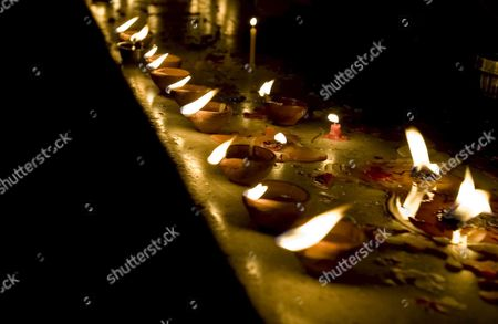 Earthenware Lamps and Candles Are Lit Along the Holy Pond of the Illuminated Golden Temple the Most Sacred Place For Sikhs All Over the World in the Northern Indian City of Amritsar India Amritsar