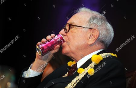 Warren Edward Buffett Chairman and Chief Executive Officer of Berkshire Hathaway and One of the Richest Men in the World Having a Sip During the Best Innovators For the Year 2010 Organised by Confederation of Indian Industry (cii) in Southern Indian City of Bangalore on 23 March 2011 Visiting India For the First Time Warren E Buffett Had Said He was Looking to Invest in Large Countries Like India China and Brazil But Added That Restrictions on Foreign Ownership in Indias Insurance Industry Could Act As a Deterrent in the Sector India Bangalore