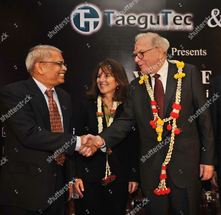 Infosys Technologies Chief Executive Officer S Gopalakrishnan(l) Shaking Hands with Warren Edward Buffett (r) Chairman and Chief Executive Officer of Berkshire Hathaway and One of the Richest Men in the World During the Best Innovators For the Year 2010 Organised by Confederation of Indian Industry (cii) in Southern Indian City of Bangalore on 23 March 2011 Visiting India For the First Time Warren E Buffett Had Said He was Looking to Invest in Large Countries Like India China and Brazil But Added That Restrictions on Foreign Ownership in Indias Insurance Industry Could Act As a Deterrent in the Sector India Bangalore