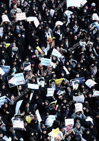 Thousands of Iranian Government Supporters Stage a Protest Demonstration Against Opposition Leaders on 18 February 2011 in Tehran Iran More Than 200 Legislators Several Clerical Groups and Government Supporters Have Called For the Arrest and Execution of Mir-hossein Moussavi and Mehdi Karroubi For Allegedly Undermining the Islamic System and Collaborating with Foreigners Thousands of Government Supporters Gathered After Friday Prayers in Enqelab Square in Central Tehran and Took Up the Call Shouting 'Moussavi and Karroubi Should Be Hanged ' Iran (islamic Republic Of) Tehran