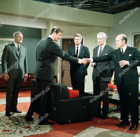 Stock Photo of 'The Saint' TV - 1968 - The Scales of Justice - Andrew Keir, Roger Moore, Mark Burns, Ronald-Hunt, Geoffrey Chater