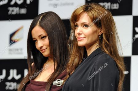 Us Actress Angelina Jolie (r) Poses For Photographers with Japanese Actress Meisa Kuroki (l) During a Press Conference to Promote Her Latest Film Salt in Tokyo Japan 27 July 2010 the Movie by Australian Director Phillip Noyce Opens in Japanese Theaters on 31 July Japan Tokyo