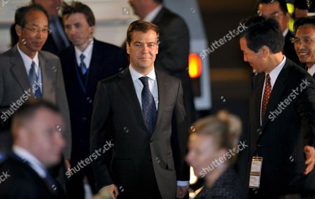 Russian President Dmitry Anatolyevich Medvedev (c) Walks Toward His Limousine Upon His Arrival at the New Chitose Airport Northern Japan to Make His Debut at the Group of Eight Summit Talks in Toyako Northern Japan 06 July 2008 the Three-day G8 Summit Will Begin July 7
